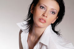 Portrait in white shirt. Photosession of young pretty woman dressed in white shirt Stock Photo