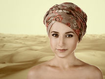 Portrait of white-skinned girl in a turban. caucasian woman with Stock Photos