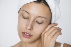 Portrait of white woman doing her daily skincare routine Royalty Free Stock Photography