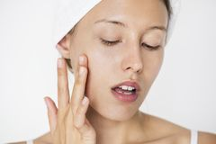 Portrait of white woman doing her daily skincare routine Royalty Free Stock Photo