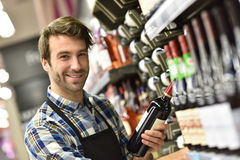 Portrait of wine specialist in wine section working Stock Photos