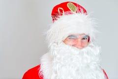 Portrait of winking Santa Claus. Stock Photos