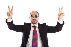 Portrait of a winner. Businessman with dollar-sign glasses standing and showing the win sign Stock Photo