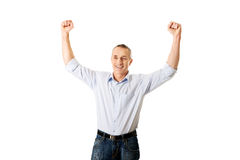 Portrait of a winner mature man with arms up Royalty Free Stock Images