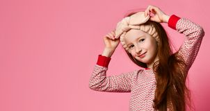 Portrait of winsome girl in her pink pajamas and a soft headband is painted in the frame. stock images