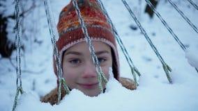 Portrait of a winter boy playing near a hammock. stock video