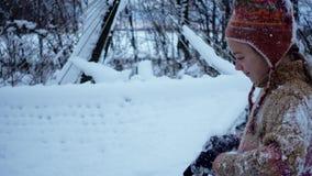 Portrait of a winter boy playing near a hammock. stock footage