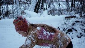 Portrait of a winter boy playing near a hammock. stock video footage