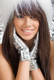 Portrait of winter girl wearing white fur Royalty Free Stock Photography