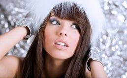 Portrait of winter girl wearing white fur Stock Image