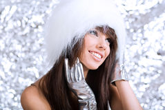 Portrait of winter girl wearing white fur Stock Images