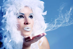 Portrait of winter queen. Blowing snow Royalty Free Stock Images