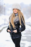 Portrait of winter woman with snow Stock Photos