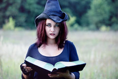 Portrait of a witch with a book, close-up Royalty Free Stock Photography