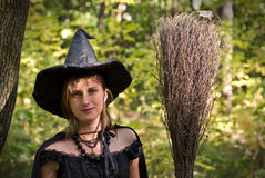 Portrait of Witch with Broomstick Royalty Free Stock Images