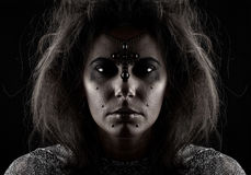 Portrait of a witch on a dark background Stock Photos