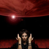 Portrait of a witch on a dark red background Royalty Free Stock Images