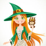 Portrait of a witch with a familiar owlet Stock Photography