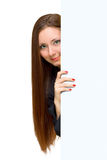 Portrait of  woman. Closeup portrait of attractive  woman looking to focus with big white paper Royalty Free Stock Image