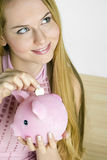 Portrait of woman. With a piggy bank Royalty Free Stock Photo
