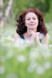 Portrait of the woman. In park in a grass Royalty Free Stock Photos