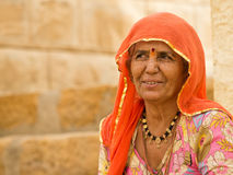 Portrait of a woman. Portrait of an elderly woman, seduda in front of the House Royalty Free Stock Photography