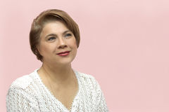 Portrait of the woman. Portrait of the middle-aged woman on a pink background Royalty Free Stock Images
