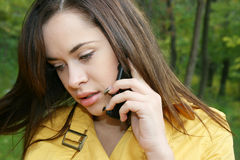 Portrait of a woman. Talks by phone Stock Photo
