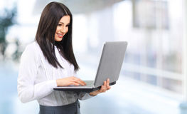 Portrait of a woman administrator with laptop. Photo has a empty space for your text Stock Photos