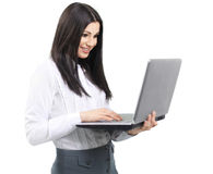 Portrait of a woman administrator with laptop on white backgroun. Portrait of a woman administrator with laptop in the white backgroun Stock Image