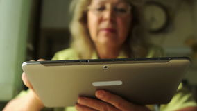 Portrait of a woman at the age with Tablet PC stock footage