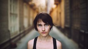 Portrait of woman in alleyway