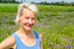 Portrait of a woman amid the summer meadows Stock Photos