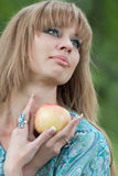 Portrait of the woman with an apple Royalty Free Stock Images
