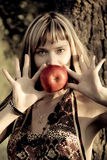 Portrait  of woman with apple in front her head. Portrait of woman with apple  near head Royalty Free Stock Image