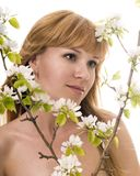Portrait of the woman among apple-trees Royalty Free Stock Images