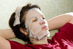 Portrait  woman applying rejuvenating facial mask on her face Royalty Free Stock Images