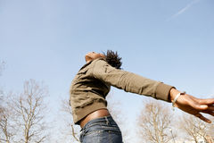 Portrait of woman with arms outstretched. Stock Photo