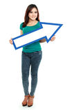 Portrait of woman with arrow sign Stock Photos