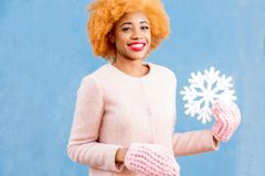 Portrait of a woman with artificial snowflake on the blue background Royalty Free Stock Photography