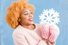 Portrait of a woman with artificial snowflake on the blue background Royalty Free Stock Photos