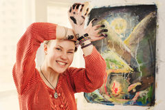 Portrait of woman artist with quirky expressions Stock Photo
