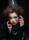 Portrait of woman with artistic make-up Stock Images