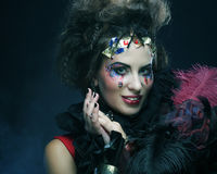 Portrait of woman with artistic make-up in blue smoke Royalty Free Stock Photography