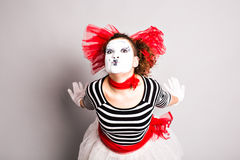 Portrait of the woman as mime sending a kiss. Concept of love and april fools day Stock Photo