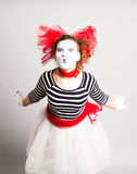 Portrait of the woman as mime sending a kiss. Concept of love and April Fools Day. Stock Photos