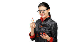 Portrait of woman with asian chef uniform hold chopsticks. Isolated on white Royalty Free Stock Photography