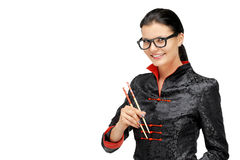 Portrait of woman with asian chef uniform hold chopsticks. Isolated on white Royalty Free Stock Images