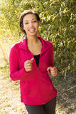 Portrait of a woman in athletic clothing. Royalty Free Stock Image