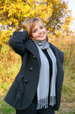 Portrait of woman on autumn background Stock Photography